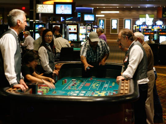 A guest plays craps at Agua Caliente Casino Resort Spa in Rancho Mirage at the craps table October 1, 2011.