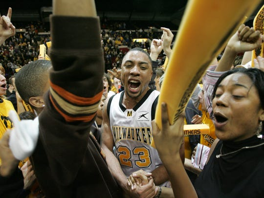 UWM's James Wright celebrates UWM victory over Butler, 64-53 with fans at the US Cellular Arena Wednesday, Feb. 16, 2005.