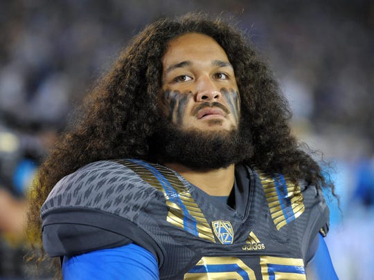 UCLA Bruins defensive lineman Ainuu Taua (35) looks on during the second quarter against the Arizona Wildcats at Rose Bowl.