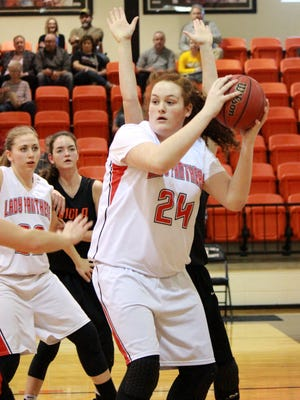 Norfork's Hannah Bryant looks to pass during the Lady Panthers' win over Viola on Thursday night.