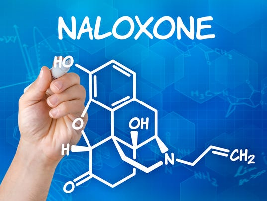Hand with pen drawing the chemical formula of naloxone