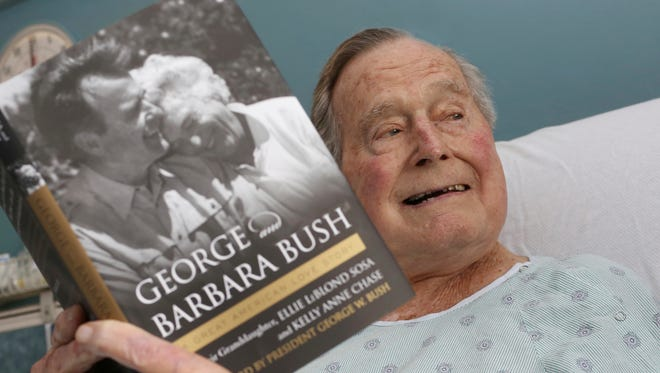 This photo provided by Office of George H. W. Bush shows a photo of former president George H.W. Bush that has tweeted on June 1, 2018 from his hospital bed while reading a book about himself and his late wife in Biddeford, Maine.