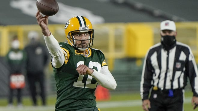 Green Bay Packers' Aaron Rodgers throws a touchdown pass during the second half of an NFL football game against the Philadelphia Eagles Sunday, Dec. 6, 2020, in Green Bay, Wis. The pass was Rodgers' 400th career touchdown pass.
