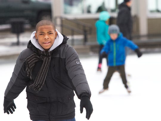 Demonte Dudley, 14, of Rochester ice-skates at Manhattan