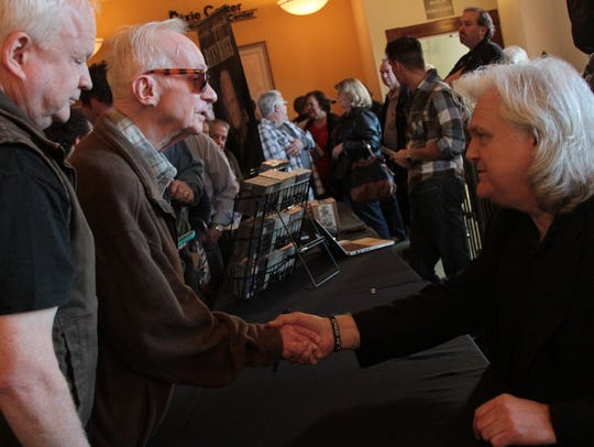 Ricky Skaggs talks with fans in the lobby at The Dixie