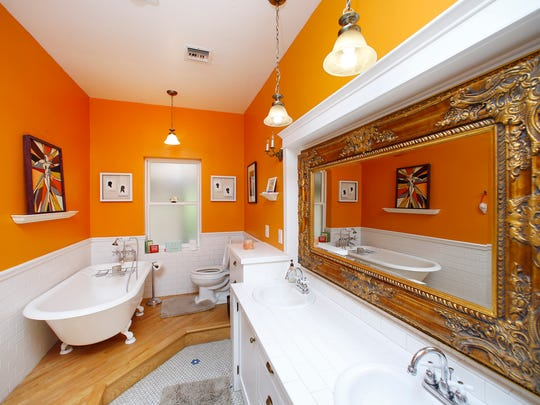 A claw-foot tub brings vintage elegance to the bathroom in the Obergh home Monday, Oct. 6, 2014 in Phoenix, Arizona.