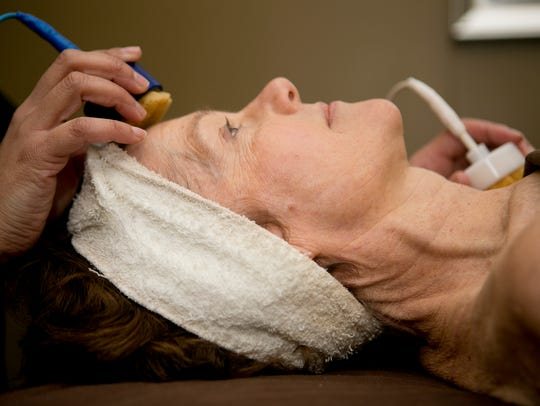 Joni receives a facial at Contours Body Sculpting in