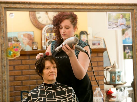 Katrina gives Joni a haircut at Studio 211 in Marshfield,