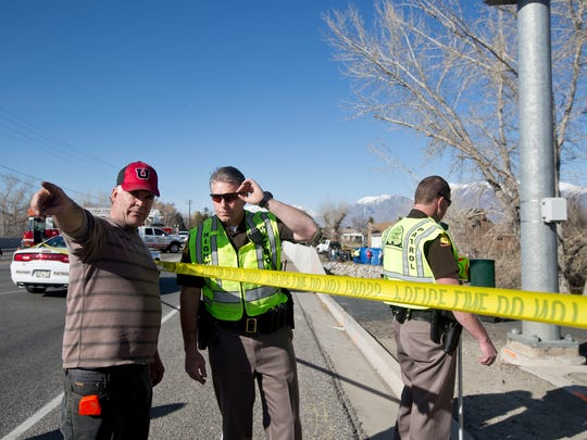In this March 7, 2015 photo, officials respond to a report of car in the Spanish Fork River near the Main Street and the Arrowhead Trail Road junction in Spanish Fork, Utah. An 18-month-old girl survived a car crash in a frigid Utah river after being strapped in a car seat upside-down for some 14 hours before being found by a fisherman, but her 25-year-old mother, Lynn Groesbeck, of Springville, was found dead in the car, police said Sunday.
