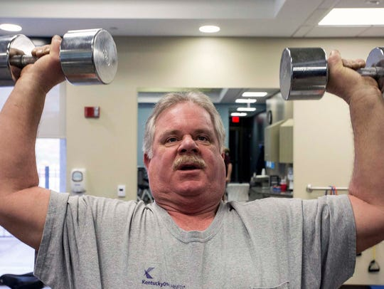 Heart attack survivor Kevin French, under the supervision