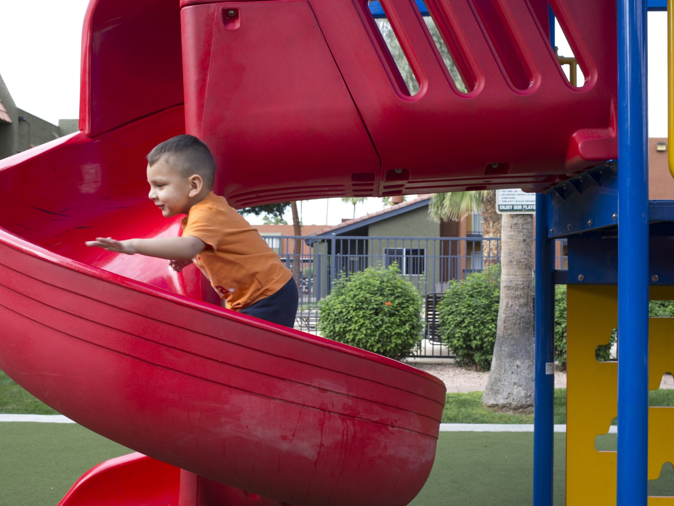Gaell Felix, 2, plays on the playground, March 19,