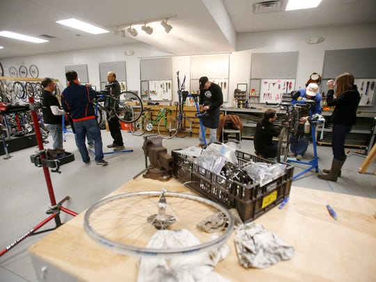 The repair area of the Newark Bike Project's community bicycle store is busy with activity last week.
