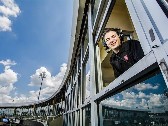 Lansing Lugnuts radio broadcaster Jesse Goldberg-Strassler at work at Cooley Law School Stadium.