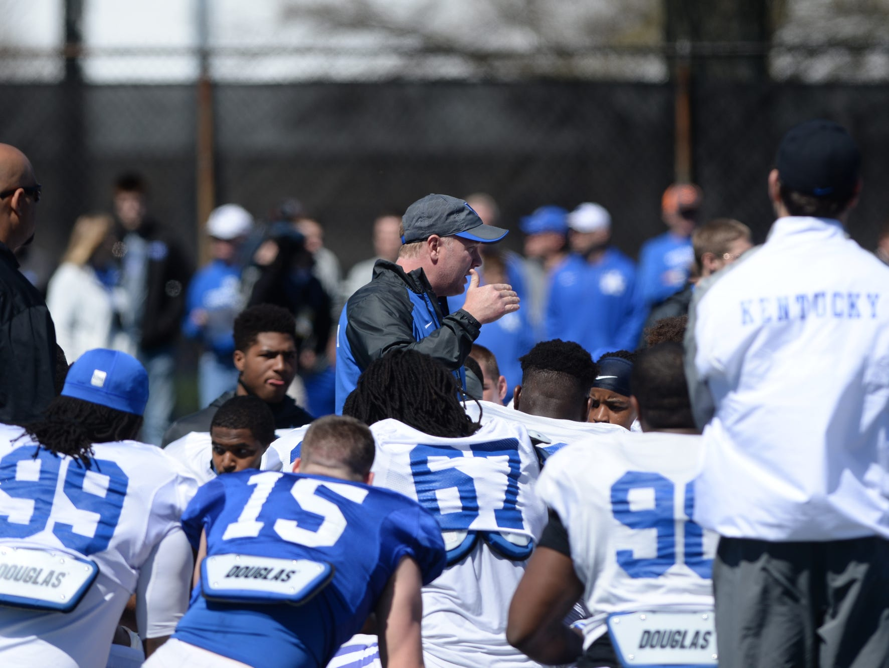 Kentucky head coach Mark Stoops addresses the team before the Kentucky football scrimmage on Saturday, April 11, 2015.