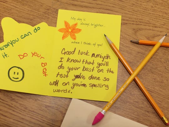 Third-graders get well wishes from family and mentors prior to the third-grade reading test.