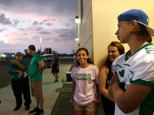 Dawson Degroot, right, waits during a weather delay before the Fort Myers-Island Coast spring game in 2015 in Cape Coral.