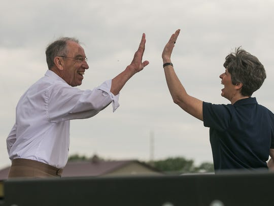 Iowa Senior Senator Chuck Grassley high fives Senator