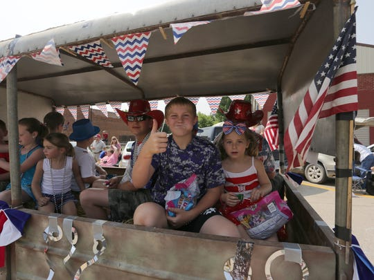 Kids ride on a float in the Fourth of July Parade in Milo.
