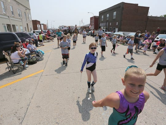 Baton twirlers walk in the Milo Fourth of July Parade.