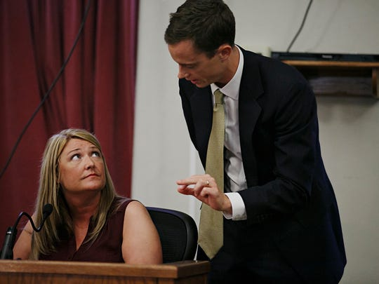 Assistant Attorney General 1 Robert Sand, right, goes over the deposition of witness Noelle Krueger with her during Tipton's trial at the Polk County Courthouse on Wednesday, July 15, 2015. Tipton is a former Multi-State Lottery Association security director who allegedly rigged the lotto to win $14 million.