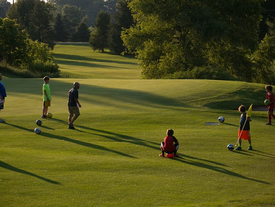 Players convene on the green area during a round of