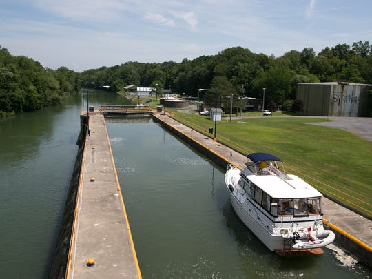 A boat passes through lock 3 of the Cayuga-Seneca Canal