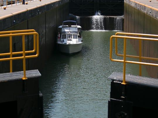 A boat passes through lock 2 of the Cayuga-Seneca Canal