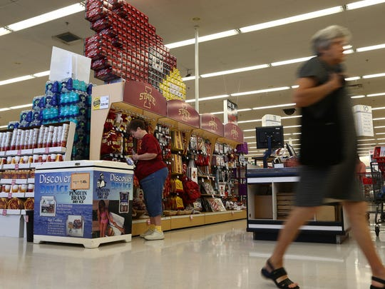 Shoppers check out the Iowa State merchandise display recently at the Ames Hy-Vee on Lincoln Way in preparation for this year's Iowa-Iowa State game.