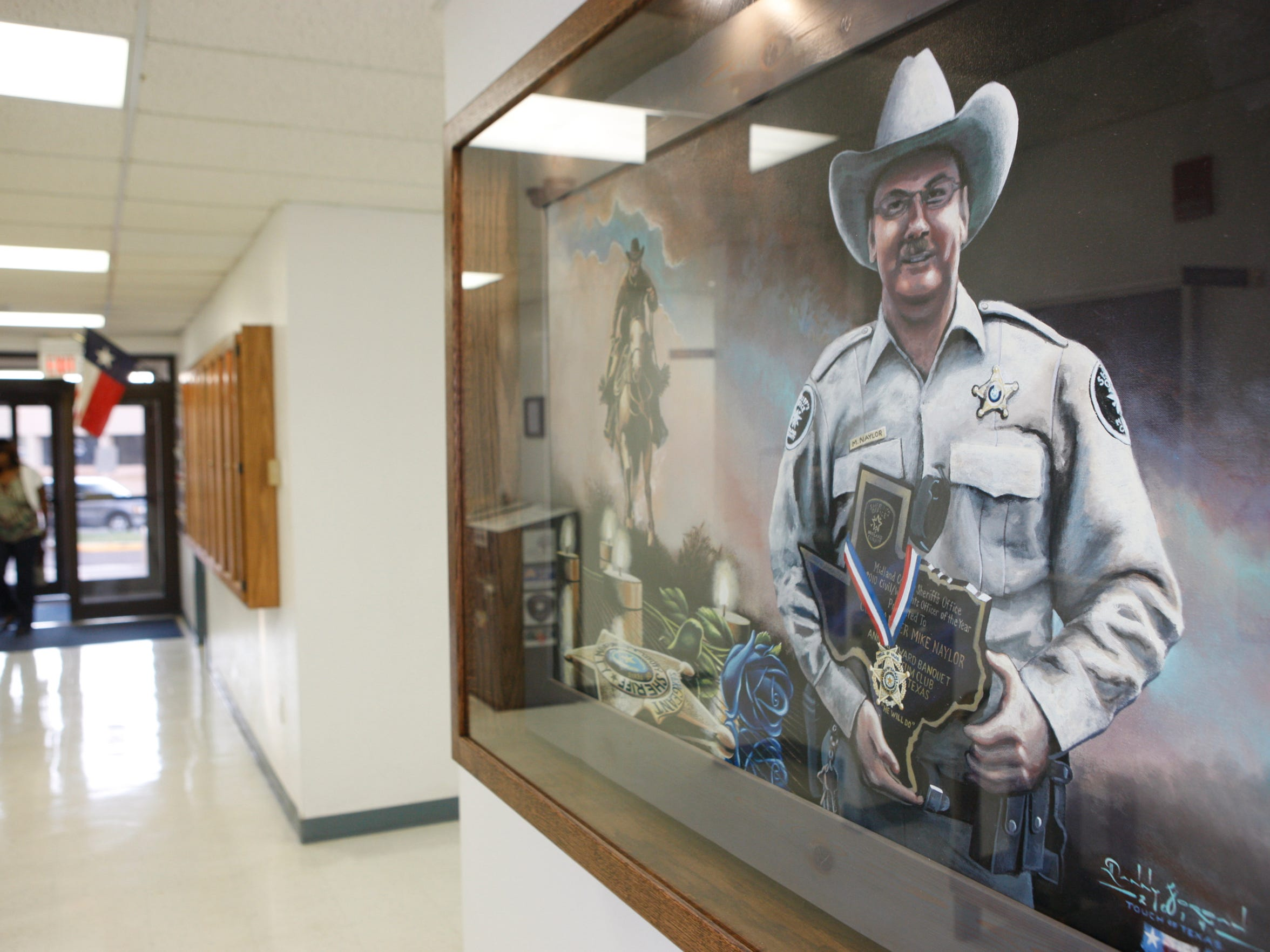 A portrait of Sgt. Michael Naylor hangs in the William Ahders Justice Center that houses the Sheriff's Department in Midland, Texas.
