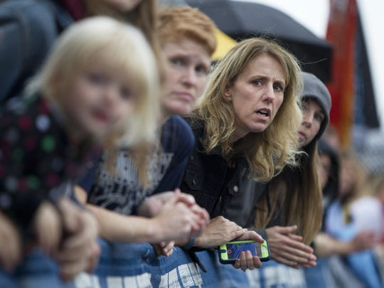 Crystal Polk of Penfield watches for runners at the