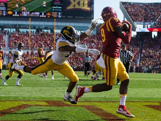 Iowa State University's Quenton Bundrage (9) catches