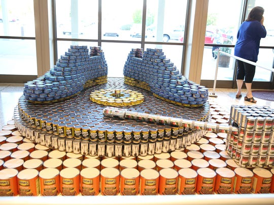 Blue Suede Shoes by Toyota Bodine, one of 14 canstructions for RIFA's 11th Canstruction contest, won Best in Show at the Carl Perkins Civic Center.