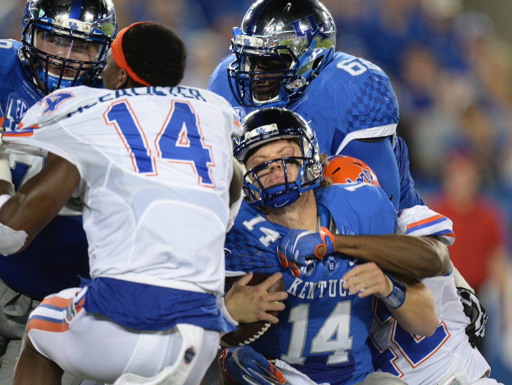 UK QB Patrick Towles is sacked during the first half of the University of Kentucky - Florida football game at Commonwealth Stadium in Lexington, Ky., on Saturday, September 19, 2015.