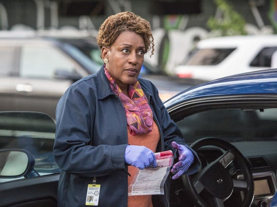 Dr. Loretta Wade (CCH Pounder) collects evidence and looks for clues in 'NCIS: New Orleans.'