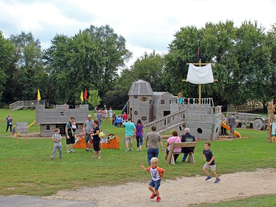Structures in Skelly's Farm Market playground include a pirate ship and castle to climb.