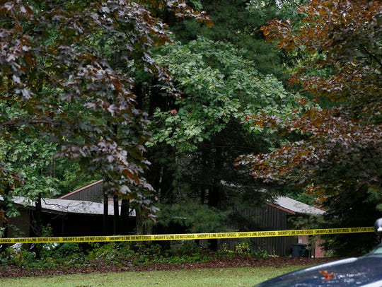 More than 20 police units surrounded Thomas and Kelley Clayton's 2181 Ginnan Road residence in Caton on Sept. 29, 2015.