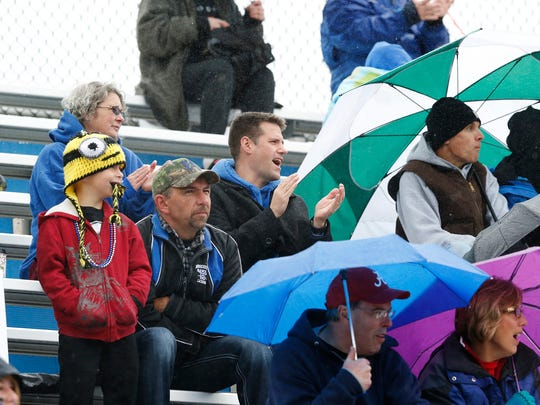 Spectators of Horseheads home football game sought cover from umbrellas while others braved the rain at the Saturday game which also celebreated homecoming. The Raiders took on Ithaca.