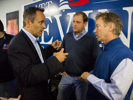 Matt Bevin, left, Congressman Andy Barr, center, and Sen. Rand Paul talk after a rally at Kentucky State University's Baptist Campus Ministry in Frankfort, Ky. October 3, 2015.