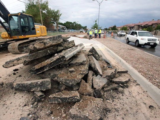 Large chunks of asphalt paving are stacked along the