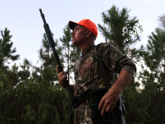Hunter Terry Beard, of Fort Myers, readies his shotgun