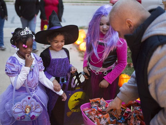 Faith Mincer, 6, left, is led over by her cousins,