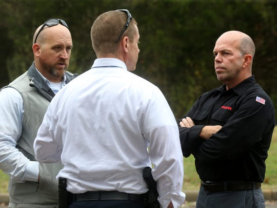 Darren Hawkins, right, brother of murder victim Gregg Hawkins, Wednesday, Nov. 4, 2015, talks with Sheriff's Office Detective Capt. David Hailey, left, and Detective Kyle Norrod at the Mona Boat Ramp , the site where Gregg Hawkins died.