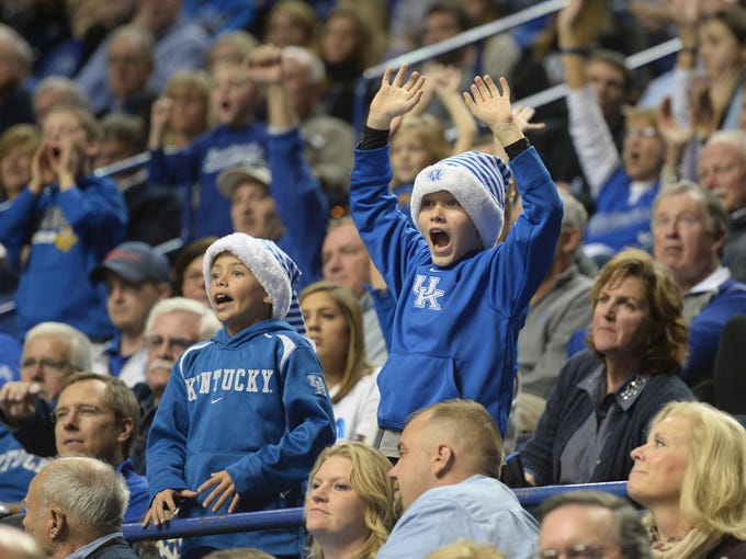 Young fans cheer during the University of Kentucky