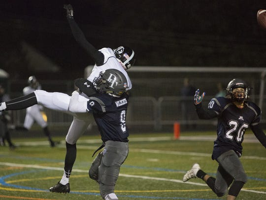 Dallastown's Anthony Garcia defends a Central Dauphin East receiver while Garcia's teammate, Max Teyral, right, intercepts the pass during Friday's District 3 Class AAAA first-round game.