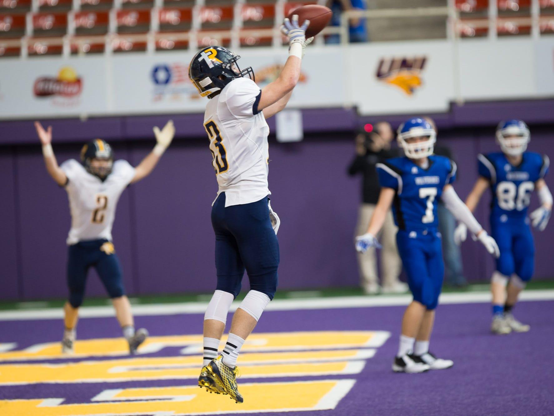 Iowa City Regina wide receiver Ethan Suchomel (13) catches a touchdown pass Saturday, Nov. 14, 2015 at the UNI Dome in Cedar Falls.
