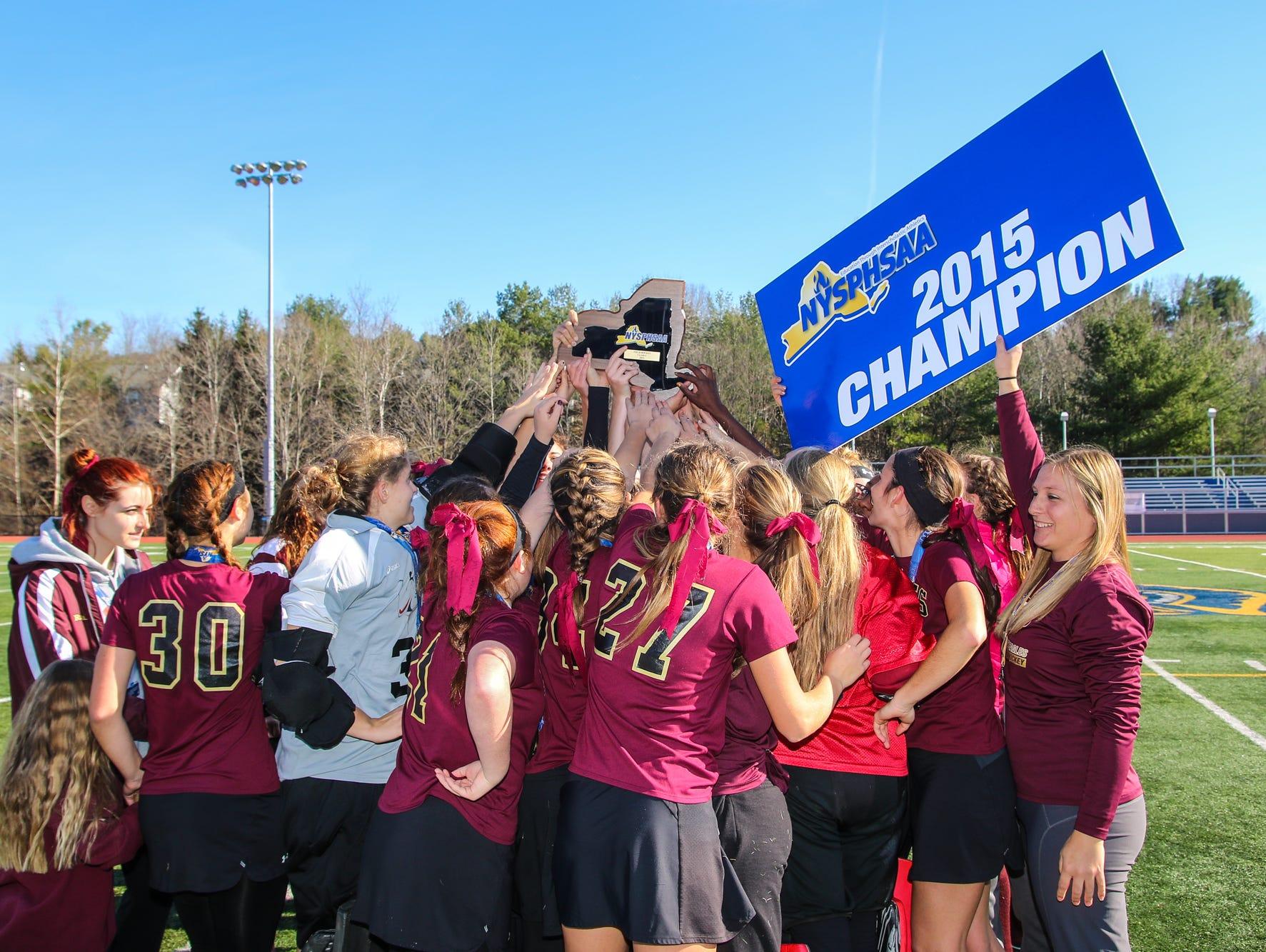 The Whitney Point field hockey team celebrates its Class C state championshipy.