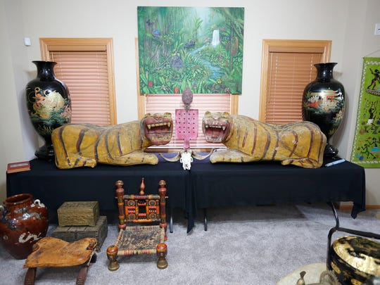 Chinese lacquered vases, Indonesian wooden tigers and a camel saddle from Abu Dhabi (front left) are part of a private collection of art that Ted Townsend plans to sell in a tag sale Nov. 20-22 in Urbandale.
