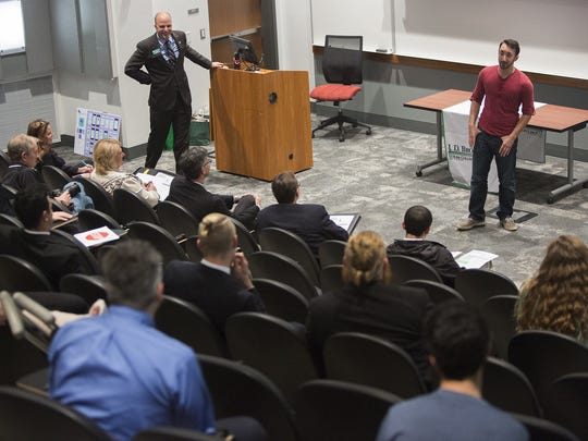 2013 Student Elevator Pitch competition winner Kyle Musco, right, gives an update on the progress of Moena, the start-up company he co-founded.