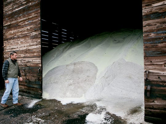 County engineer Roland Hawk opens up the salt shed at the Wood County Highway Department in Wisconsin Rapids, Wednesday, Nov. 18.