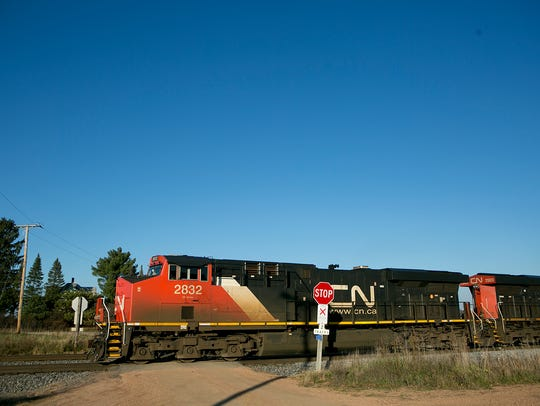 A Canadian National train passes in front of the home
